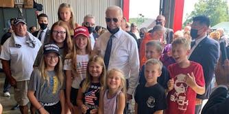 Joe Biden with children wearing MAGA clothing
