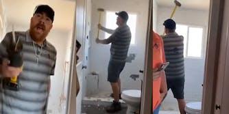 man demolishes bathroom