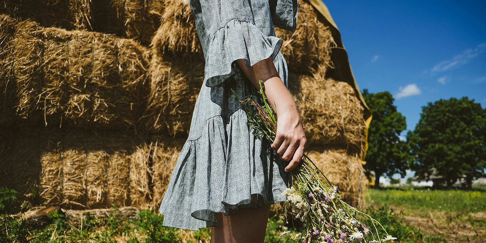 A girl wearing a dress on a farm.