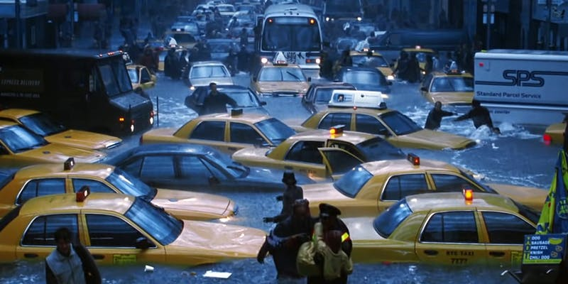 flooded NYC street filled with people, cabs, and buses