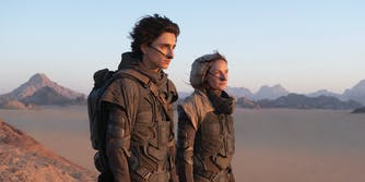 man and woman in stillsuits