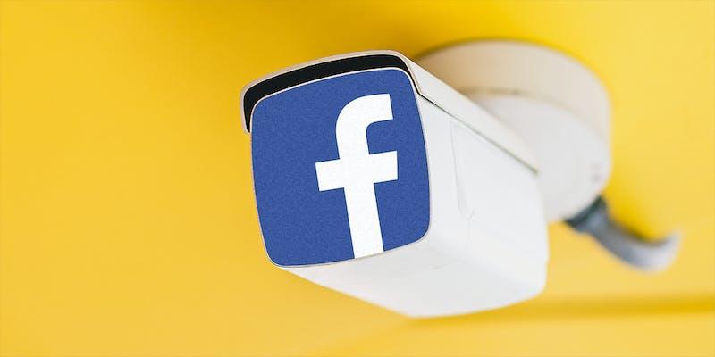 A surveillance camera with Facebook logo.