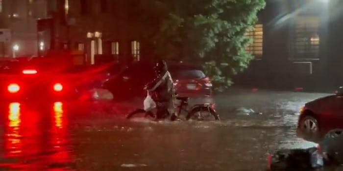 grubhub delivery on bicycle in flood