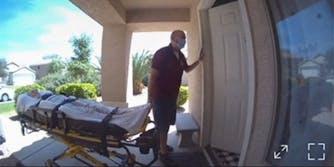 woman on stretcher, man at door