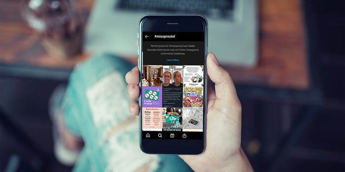 woman holds phone with instagram censored hashtag #misoprostol