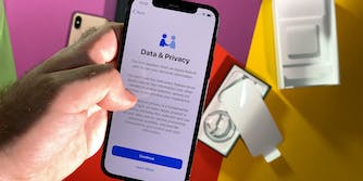 POV male hand setting new iPhone 12 Pro latest smartphone with 5g reading about data and Privacy during setup