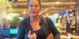 A woman yelling at camera.