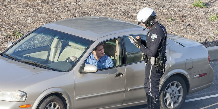 Los Angeles Police Department Police officer issuing a driver with a citation (ticket) for driving offences.
