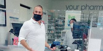 A man at a pharmacy looking into camera.