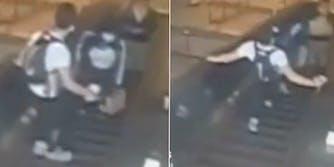 man pushes woman down escalator
