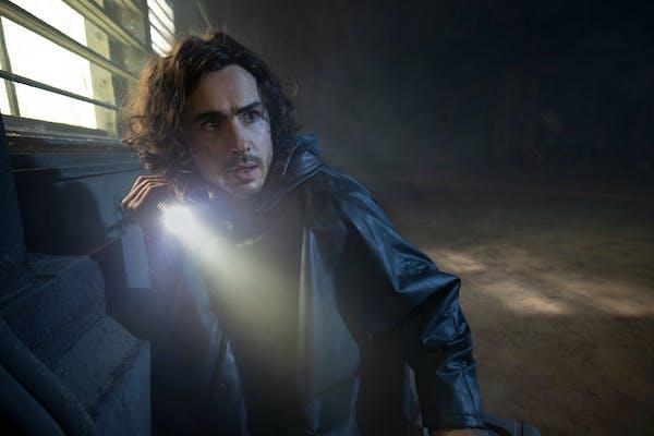 man holding a flashlight