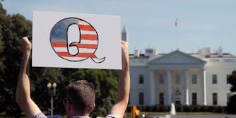 A man holding a sign.