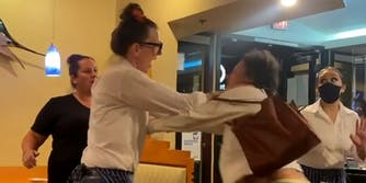 woman fights with staff at restaurant