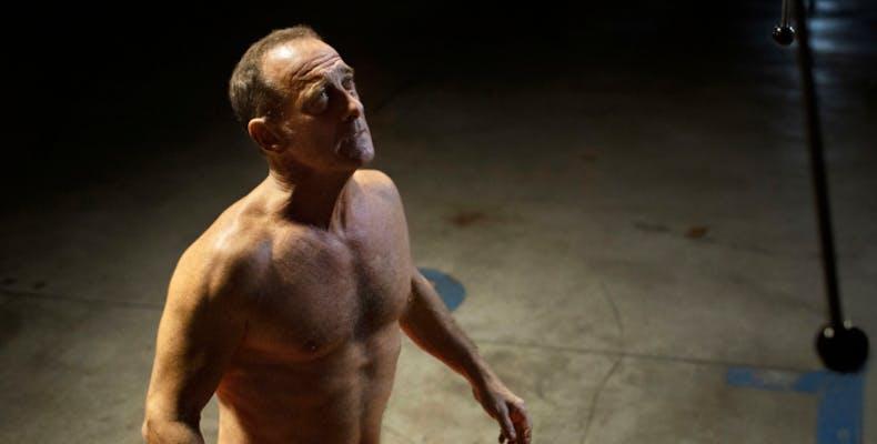 a shirtless man in Titane