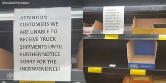 """empty shelves with sign that reads """"Attention customers we are unable to receive truck shipments until further notice sorry for the incovnenience!"""""""