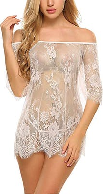 Blonde woman wearing see though white chemise with matching lace thong from one of the best places to buy lingerie online