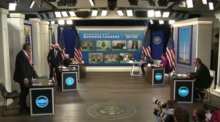 President Joe Biden hosting a meeting in the South Court Auditorium.