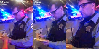 Police officer taking a woman's ID and writing in a notebook.