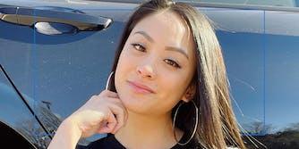 Megan Reyes in front of a car door