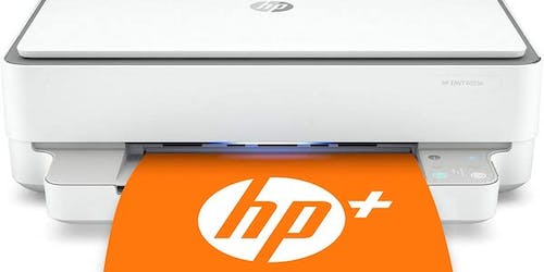 Sleek white and silver printer with orange paper sporting the HP logo