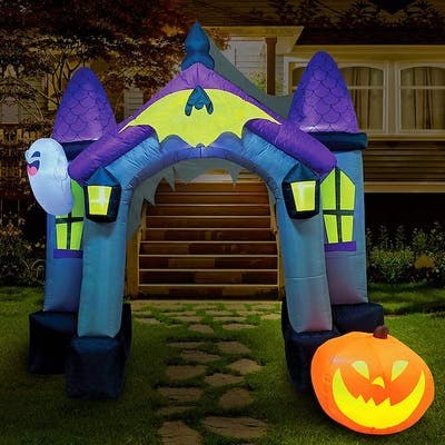the best outdoor halloween decoration might be this inflatable haunted house with ghosts and pumpkins