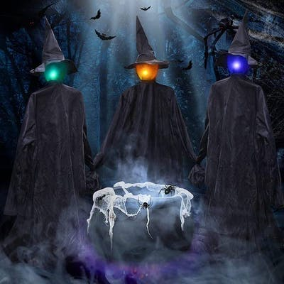 Three light up witches in black gowns and pointy hats gather around a bubbling caldron