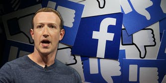 Facebook CEO Mark Zuckerberg in front of a background made up of the Facebook logo and thumbs down.