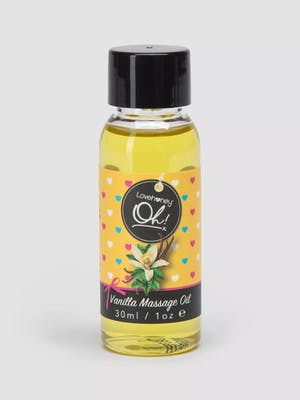 Bottle of love honey vanilla massage oil with black cap and black text