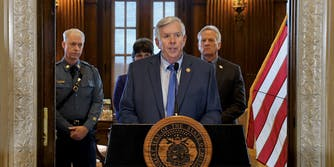 Missouri Gov. Mike Parson holding a press conference where he branded a journalist a 'hacker' for viewing the HTML source code of a government website.