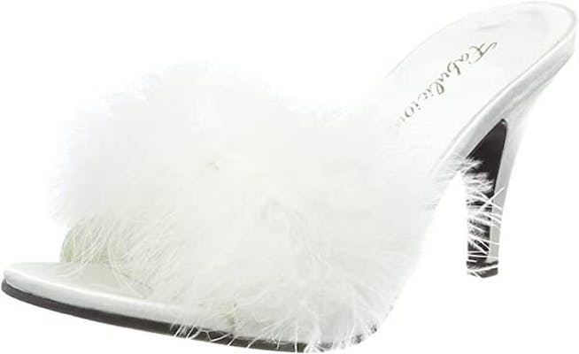 White kitten pleaser heels with white feathers at the front