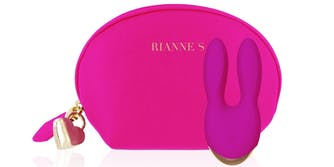 Rianne vibrator, a pink device with two bunny ear shaped prongs, in front of a carying case