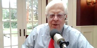 A man talking into a microphone at a residential home.