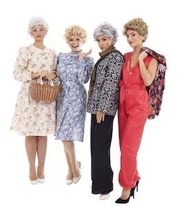Four women in their twenties and thirties wearing halloween costumes of the Golden Girls