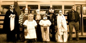 Best group Halloween costumes - screen shot from Trick r' Treat of a group of scary children in scary halloween costumes like dracula and a clown