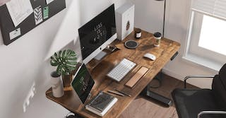 home office featured image, a photo of a home office desk with a imac, ipad, keyboard, and papers