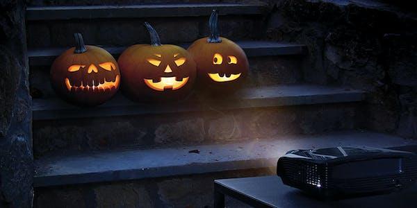 Charming jack-o-lantern trio projected onto walkway