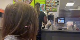 young girl reacts to woman yelling at fast food counter