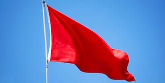 red flag blowing in the wind