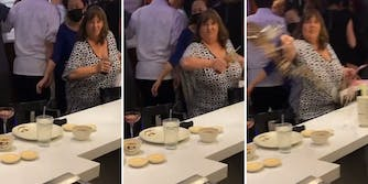 grown woman throws a drink at another patron in a restaurant