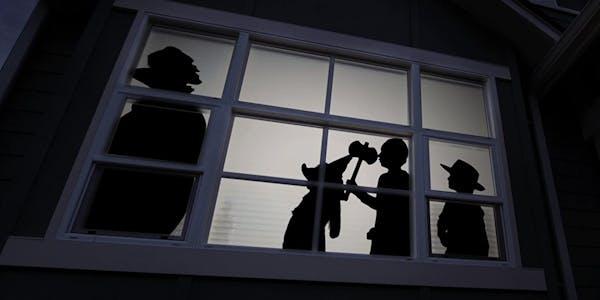 Dracula spooks trick o treaters projected onto window