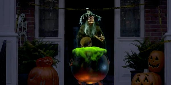 Charming witch projected into doorway