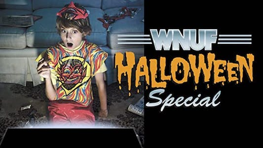 WNUF Halloween Special shudder - a scared woman sits on a sofa watching a TV special