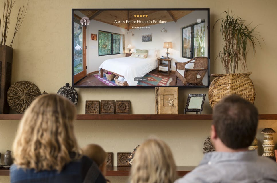 Family looking at Airbnb on Apple TV