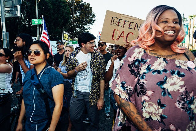 Activists march in defense of Dreamers.