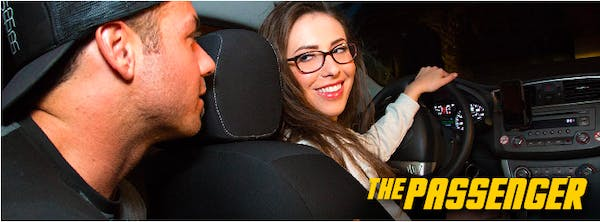 """A still from the series """"The Passenger"""" showing a woman driving a man"""