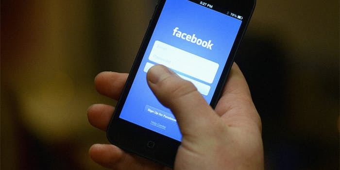 Hand opening Facebook mobile app