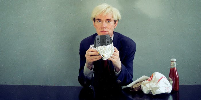 Andy Warhol eating a Nintendo Switch
