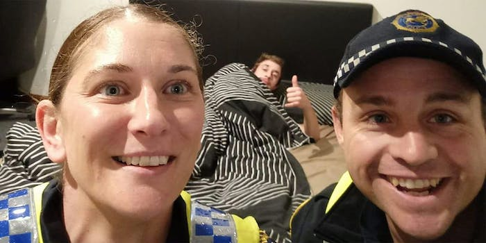 Australian police take selfie with a drunk man in his bed
