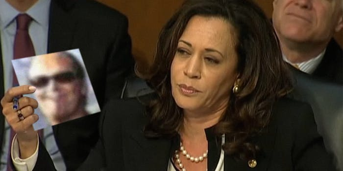 Kamala Harris holding picture of Twitter user dril