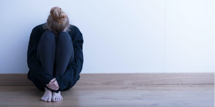woman alone anxiety depressed